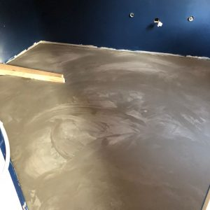Cementitious floor level applied and drying