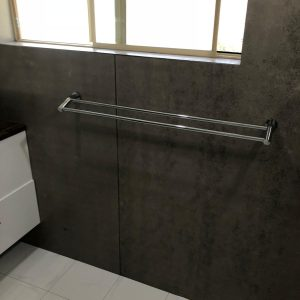 window reveal completed and waterproofed with towel rail installed
