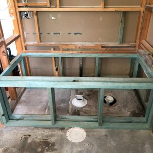 The old shower becomes the bath location framed out in treated pine