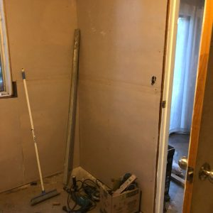 door moved to meet measurement requirements for toilet and bath location
