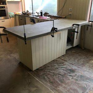 install groove cement sheeting on breakfast bar return.