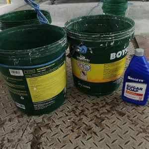 Sugar Soap in buckets tied on for cleaning with brooms